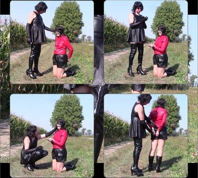 Mistress smokes, Angela kneeling and handcuffed